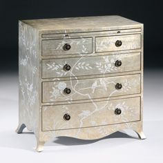 """Hand-painted five drawer chest with floral and bird design, crackled silver finish, pull out writing shelf and antiqued brass hardware, 29¼"""" w. x 17½"""" d. x 30¼"""" h."""