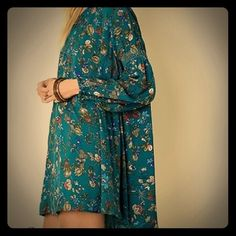 Teal Keyhole Tunic dress Top Beautiful tunic with floral design. Color is a beautiful deep real. Cinched upper arms and button neck. Worn once! Super cute! Size is a large but this could fit a medium as well. *Not listed brand* Free People Tops Tunics