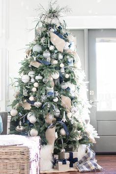 How To Put Ribbon On A Christmas Tree 2020 Tutorial A Pop Of Pretty Christmas Tree Garland Ribbon On Christmas Tree Blue Christmas Decor