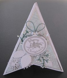 Pyramid card, with Tim Holtz holiday greens mini dies.