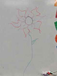 Flower on dry erase board.