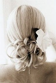 Bridesmaids hairstyle more towards the side with a braid on the opposite side.