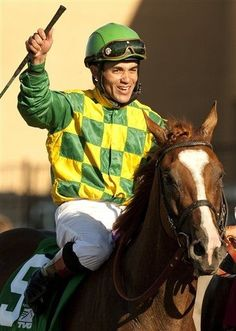 Joel Rosario celebrates aboard Dullahan after their victory in the Grade I $1,000,000 Pacific Classic horse race, Sunday, Aug. 26, 2012