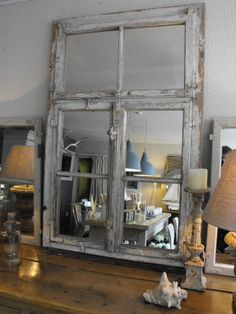 take old window and put a mirror behind it then I want to hang it on the wall by the couch to make it look like a outside window
