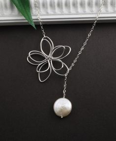 Flower and Pearl Lariat from Etsy. Perfection.