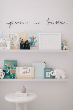 Nursery Reading Corner With Ikea Painted Ledges And Once Upon A Time Wire Sign - Image By Adam Crohill. Pale Grey, Neutral Nursery With Subtle Blush, Blue And Mustard Accents