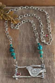 Gorgeous sterling silver statement necklace withan open framed branch pendant, opaque red coral beads anda striking textured sparrow. Created asareminder tolay ourworries before God, who cares for the sparrows and cares for us. Hung from an adjustable oxidized chain,interspersed with turquoise beads. Inspired by Matthew 6:26-27