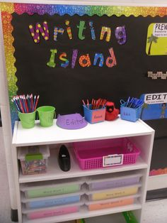First Grade Classroom: Writing Island with lots of papers, pens and other unique supplies for students to use during writing time. Classroom Organisation, Classroom Design, Classroom Decor, Writing Center Organization, Modern Classroom, Classroom Reading Nook, Daily 5 Organization, Year 3 Classroom Ideas, Classroom Libraries
