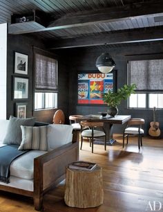 The movie room features Roman shades and a colorful painting by Jane Fisher.