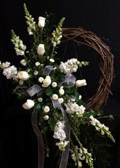 Send PS126: All White On A Grapevine Wreath Attached To A Stan in Greenbrier, TN from The Potting Shed, the best florist in Greenbrier. All flowers are hand delivered and same day delivery may be available.
