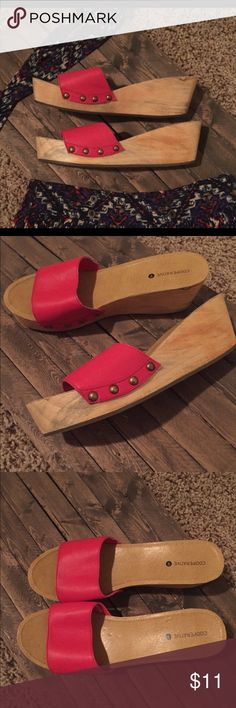 "Coral red clogs. Urban Outfitters. Slip on clog with stud detail from Urban Outfitters. Never worn. Color is coral red that will add a pop of color to any outfit. Wedge measures about 2.5"" high. Cooperative Shoes Mules & Clogs"