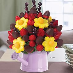 #Sweet #treats    Unless she's in the extreme minority, your mom will always appreciate sweet treats. Chocolate, of course, is certainly a safe bet, but if you're really looking to impress, sending an edible arrangement of her favorite fruit dipped in chocolate takes this gifting concept from the minor leagues to the pros. Made to be as beautiful as they are tasty, they're also great for sharing when the family gets together.