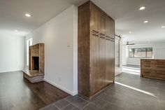 """""""After"""" photos of 10th flip - It's Great to Be Home.  Kitchen with stained maple cabinets, subway tile with gray grout, carrera marble counter, cedar + moss sconces, gray porcelain tile floor, rustic modern"""