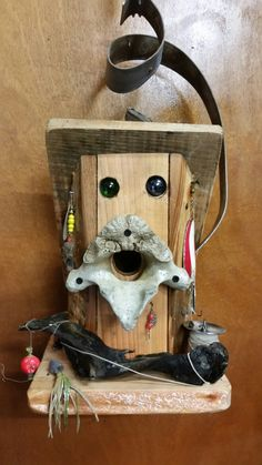 Birdhouse made from recycled wood, fishing gear, and an old seal bone. By greg theer