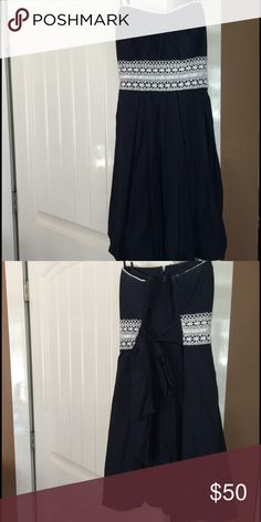dress navy blue, with white detail, only worn once for homecoming, and bought at Macy's Speechless Dresses