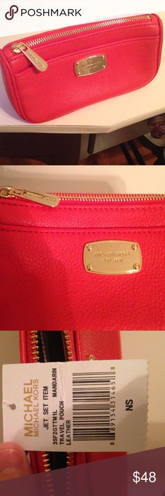 Michael Kors orange travel pouch Brand new MK with tags. Orange bag with credit card inserts and pockets inside. There is not a strap it's a clutch style bag. MICHAEL Michael Kors Bags Travel Bags