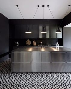 I black kitchen I stainless steel kitchen Island I black and white tiled floor Les Acrobates de Gras & edited by DCW éditions Kitchen And Bath, New Kitchen, Kitchen Dining, Kitchen Decor, Kitchen Lamps, Eclectic Kitchen, Kitchen Black, Scandinavian Kitchen, Island Kitchen