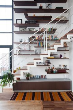 Staircase.. And those shelves.. And it looks like floor to ceiling windows in the corner there!