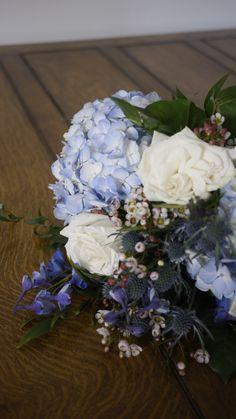 Blue hydrangea, blue delphinium, creamy white garden roses and white wax flower White Wax Flower, Wax Flowers, Blue Wedding Flowers, Blue Delphinium, Blue Hydrangea, Garden Roses, White Gardens, Creamy White, Floral Wreath