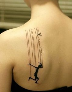 The broken line and the small details make up the tattoo.