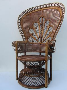 This vintage rattan peacock chair from the 1960s was handmade by a rattan/wicker craftsman and features a peacock tail woven into the back.