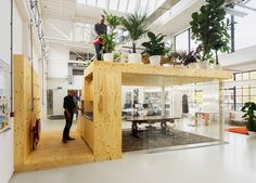 jvantspijker's renovated office includes a meeting room topped with an indoor…