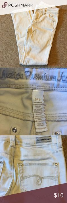 """Girls 14 slim justice stretch jeans tan color Light tan\cream stretch jeans from justice. 14 slim. Rhinestones around pockets on front and back. Inseam measures approximately 27 inches. Waist measures approximately 26"""". Great condition worn once Justice Bottoms Jeans"""