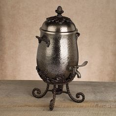 Sitting on a scrolled stand complete with warming cup, the hammered carafe exhibits the scrolled handles and hospitality pineapple lid lift made famous by the GG Collection. The spigot will dispense a full gallon of your best dark roast, $290.00
