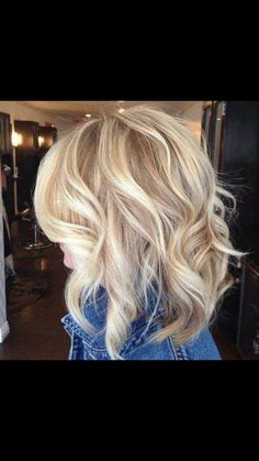 Beautiful blonde mid length curly locks