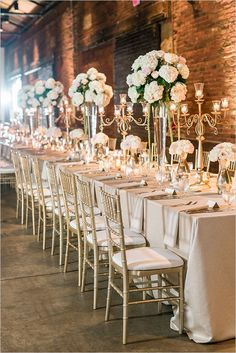 Wedding Receptions White Wedding centerpieces Gold Reception Chairs Exposed Brick Wedding Reception - Emily and Michael's Lovely Pink And Ivory Wedding day was full of little details and special touches and every single one of them is so pretty! Wedding Table Themes, Wedding Table Centerpieces, Wedding Reception Decorations, Wedding Receptions, Centerpiece Ideas, Quinceanera Centerpieces, Centerpiece Flowers, Wedding Reception Dresses, Long Wedding Tables