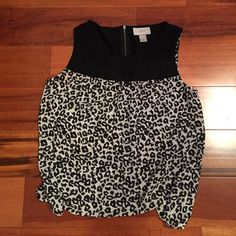 LOFT sleeveless blouse Super cute black/white LOFT blouse! Can be a shell worn under a cardigan or jacket, or it can be worn on its own! Looks great paired with shorts of jeans. Like NEW LOFT Tops Blouses