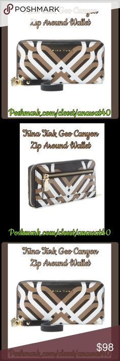 """Trina Turk Geo Canyon Zip Around Wallet Trina Turk Geo Canyon Zip Around Wallet with side detachable wrist strap zip around closure. Exterior features back zip pocket. Interior features center zip pocket with 2 bill slots and 12 card slots. Will fit Iphone 6 and Iphone 6 Plus. Approx. 4"""" H X 8"""" W X 1"""" D. Approx. 8"""" strap length. Trina Turk Bags Wallets"""