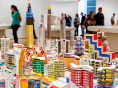 The Congolese artist Bodys Isek Kingelez had a vision of the future — and he built it out of soda cans, bottle caps, cookie packages, matchboxes, colored paper and corrugated cardboard.