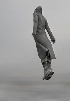 long jacket and nice shoes, not sure it's a man thou, neverless the jump gives a nice edge to the photo