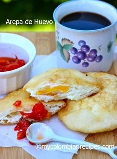 Arepa de Huevo is a typical dish from the Caribbean region of Colombia where they are sold on street stalls. These arepas are served in Colombian homes for My Colombian Recipes, Colombian Cuisine, Colombian Arepas, Colombian Breakfast, Colombian Coffee, Kitchen Recipes, Cooking Recipes, Comida Latina, Latin Food
