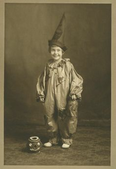 Antique Halloween photo, girl with jack o lantern candy container.