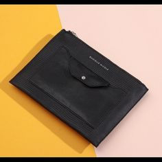 Danielle Nicole Zelie Clutch Purse Envelope Black A modern style you can carry day or night. Faux leather. Tip zip closure. Exterior features silver tone hardware and 1 front slide pocket with removable snap in pouch. 10 1/4W x 7 3/4H x 1/4D. ✨Price is Firm unless is Bundle! Save $$$ when bundling with other items. NO TRADE Danielle Nicole Bags Clutches & Wristlets