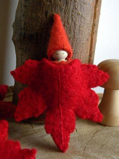This sweet little Waldorf inspired Maple Leaf & gnome play-set will be a lovely gift to a special child in your life. She would also be beautiful on your Autumn nature table or a fun prop in storytelling. I can add a string to the leaf and turn it into a Autumn ornament if you prefer. She is made with love using quality materials including upcycled wool felt, a baby peg doll, embroidery thread, pencil, AP certified finish for the face & glue. She is about 2 3/4 inches tall. The maple leaf…