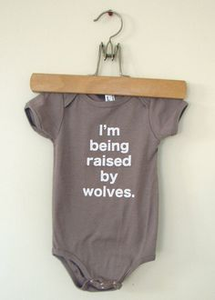 Baby onesie I'm Being Raised By Wolves 612mo by eggagogo on Etsy