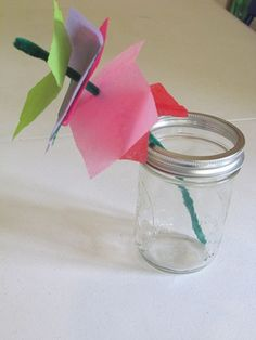 Tissue paper flower for Spring Children's craft. Can be accompanied with Lois Ehlert's Planting a Rainbow book.