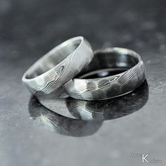 Custom Wedding Ring - Hand forged stainless damascus steel - Rocksteel. $178.00, via Etsy.