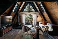 I love you, house. A dated property in the mountains of Big Bear, California, is upgraded to highlight its stunning A-frame design with some simple updates.