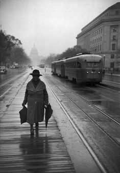 VISIT FOR MORE by Henri Cartier-Bresson USA. We love streetcars and old photos of the Capitol Building. Heres one from The post by Henri Cartier-Bresson USA. We love stree appeared first on street. Henri Cartier Bresson, Candid Photography, Vintage Photography, Street Photography, Nature Photography, Urban Photography, Color Photography, Landscape Photography, Portrait Photography