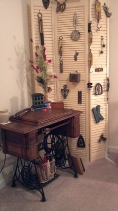 Old Singer Sewing Machine I got at a steal at an estate sale...great idea for displaying nick-nacks is the louvres. old shutters