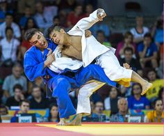 July 12 - Judo - Men's - 66 kg.  Canadian Antoine Bouchard (blue) during his Gold medal loss to Charles Chibana of Brazil in men's under 66 kg judo.
