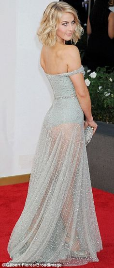 Blonde ambition: The star wore her fair hair in a curled bob and showed off her stunning figure in the mint green dress which featured a see...