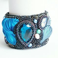 Bead embroided statement bracelet with shibori silk.