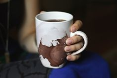 I LOVE this. Just nail polish in a pie tin of water, then dip the mug in!