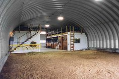 RocketBuildings.com Horse Barns- the idea of having stalls and indoor connected. Would need large ventilation fans and footing that was known for being low on dust.