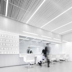 Mexican architect Abraham Cota Paredes has given this hair salon in Guadalajara a minimal makeover hiding beauty products and accessories in the all-white space. Interior Design 2017, Interior Design Living Room, Room Interior, White Hair Salon, Barber Shop Decor, Hair Salon Interior, Barbershop Design, Beauty Salon Design, Minimalist Interior